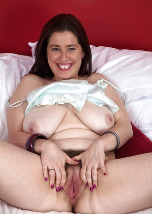 Extremely hairy mature Janey playing with her armpit hair and spreading