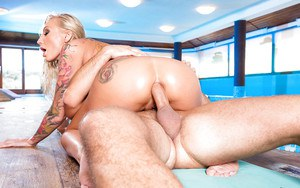 Blonde with sleeve tattoos has her huge boobs played with while giving bj