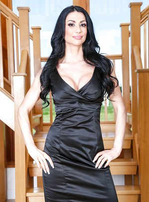 Sultry European mom Valeria Visconti poses fully clothed in dress and heels