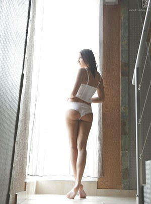Pornstar Felicia Kiss looking sultry in pretty white panties and bustier