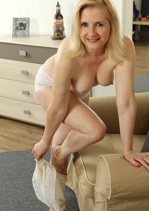 Mature blonde lady Kim Brosley strips off lingerie to masturbate