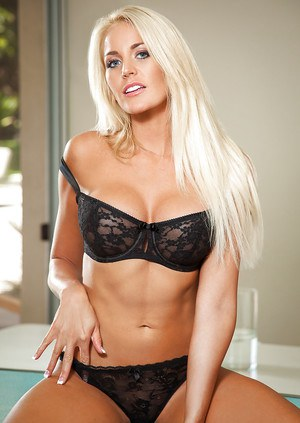Blond amateur Lindsay Love posing in black bra and panties for centerfold