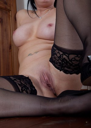 Mature MILF Tanya Cox posing solo in black stockings and high heels