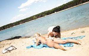 Erotic beach lesbian sex action with teen dyke Sara J and girlfriend