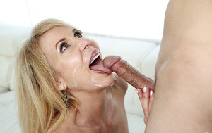 Mature blonde cougar Erica Lauren grabs hold of younger cock for tugjob