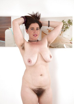 Mature woman Janey flaunting large natural tits and hairy beaver