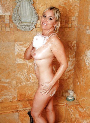 Older blonde housewife Angela Harley bares nude body after shower
