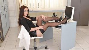 Office worker Wendy Moon parts legs to expose kinky pierced pussy