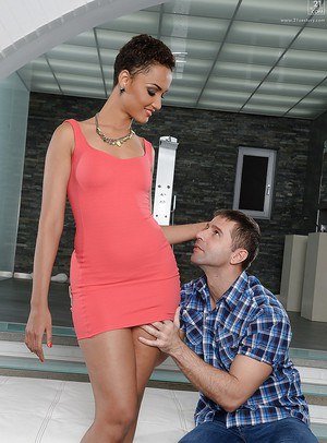 Tall ebony babe Halona Vouge being disrobed by white, male admirer