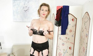Over 30 blonde mom Betsy Blue modelling the latest in stockings and garters