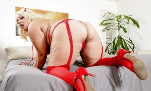 Buxom fat nurse Jade Rose poses in sexy uniform and bares her big phat ass