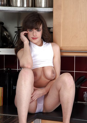 MILF housewife Katie baring her over 30 natural breasts in kitchen