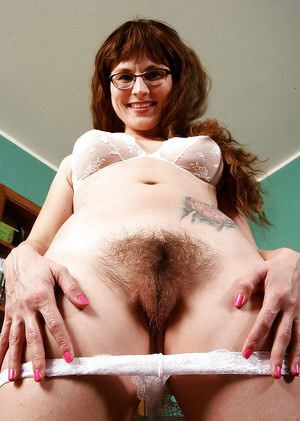 Mature lady in glasses Sofia Rodas baring hairy vagina and natural tits