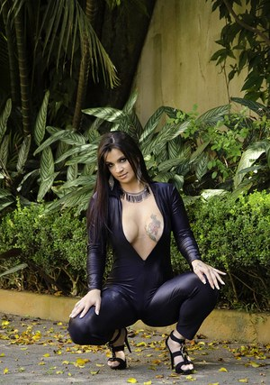 Big bottomed Latina beauty Cristine Castellari posing fully clothed outside