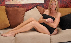 Blonde mom over fifty Pam Roberts baring her pancake breasts