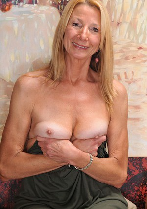 Older lady Pam Roberts pulling down yellow underwear and spreading pussy