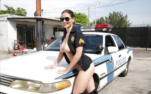 Busty policewoman in sunglasses Molly Jane flashing large natural tits