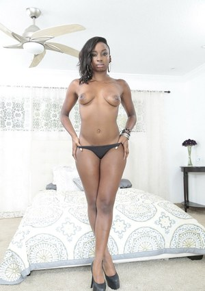Black beauty Naomi Gamble modelling solo in ripped bodystocking