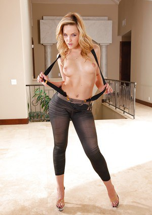 Blonde pornstar Alexis Texas posing topless in jeans and high heels
