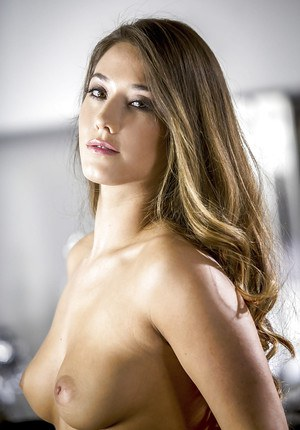 Girl next door Eva Lovia modelling in black stockings and spreading pussy