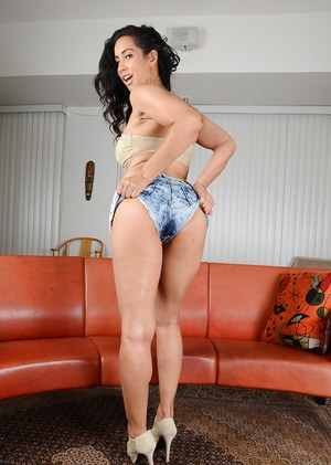 Top rated Latina MILF Isis Love posing in high heels and denim shorts