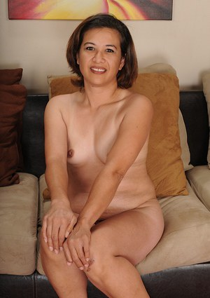Mature model Lexi Hunter stripping down to bra and underwear