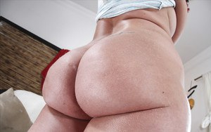 Big ass MILF Kelly Divine showing off her booty and big wet boobs