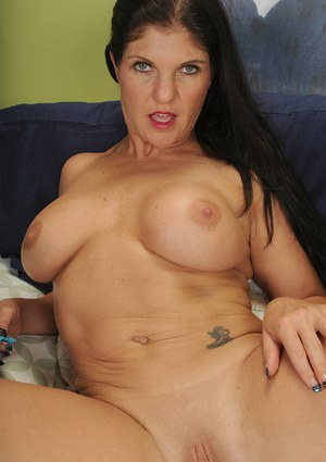 Busty big ass mature Coralyn Jewel playing with her shaved pussy