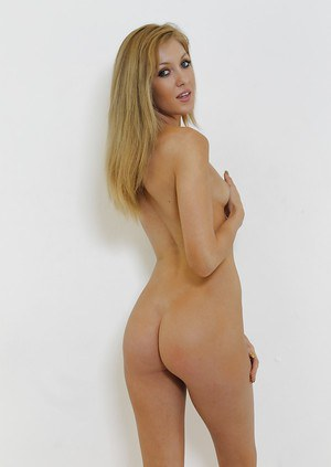 Innocent blonde babe showing off her tiny tits and perfectly round ass