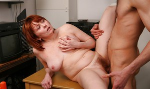 Hairy mature redhead Strekoza enjoying a young cock up her cunt