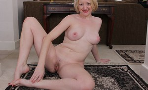 Stunning blonde MILF Anya Volcov showing off her feet and spreading