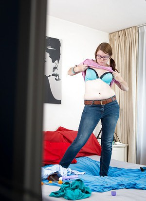 Chubby teen girl in glasses Lotte secretly filmed getting dressed