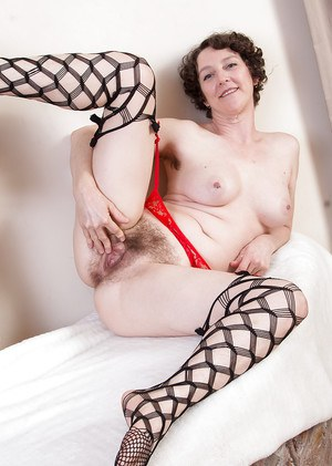 Hairy mature bombshell Artimesia showing off her pussy in stockings