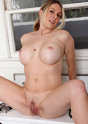 Amazing busty blonde mature Angela Attison spreading her hairy cunt