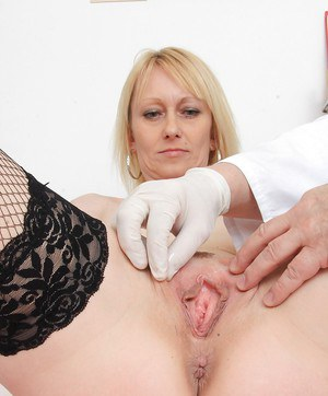 Aged blonde woman Nelly being examined by a perverted doctor