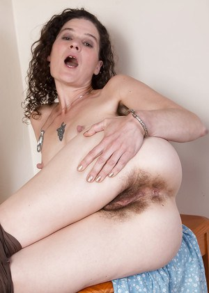 Older hirsute woman Sunshine licking her own hairy armpits