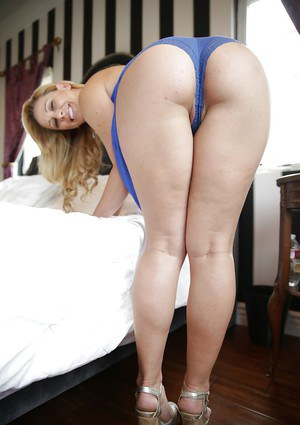 Big butt blonde pornstar Cherie DeVille bending over for round ass display