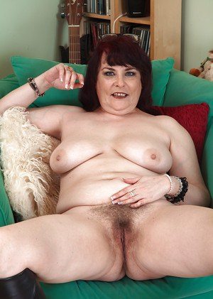 Chunky mature lady in glasses Christina X pulls panties aside to flash bush