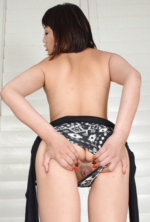 Amateur Asian model Miko Dai pulling panties aside to spread pussy and ass