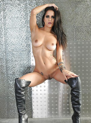 Hot Latina pornstar Abby Lee Brazil posing solo in knee high black boots