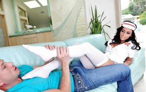Fully clothed teen nurse Whitney Westgate giving sexy footjob