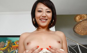 Asian amateur Miko Dai showing off puffy labia lips and butthole