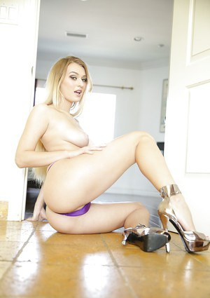 Busty pornstar Natalia Starr squeezing big juggs before flashing bald twat