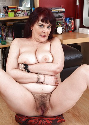 Buxom older woman Christina X poses in red lingerie before baring big juggs