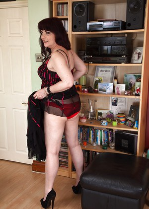 Mature redhead Christina X flashing red panties underneath sexy lingerie