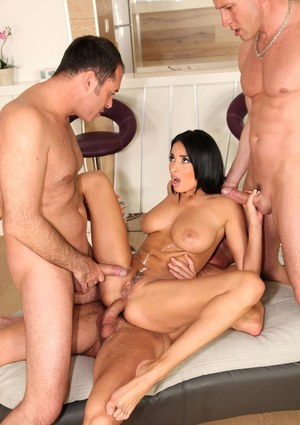 Cum loving brunette bombshell Anissa Kate getting drilled by three rods