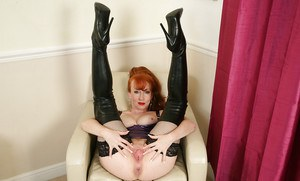 Pale mature whore Red showing off her trimmed pussy in latex
