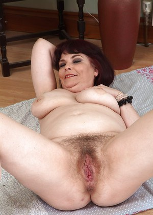 Hairy mature slut Christiana X showing off her big natural boobs