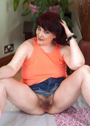 Chubby mature mom Christiana X spreading her wet hairy pussy