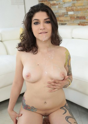 Tattooed Latina pornstar Lucy Deville giving blowjob to thick cock